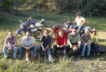 Work and Travel farm work participants with cross-bikes